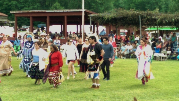 Ricky, Chirsts and Emilia dancing in an interibal at the Fond du Lac Veteran's Powwow.